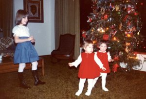 Traditional O'Connor Christmas dance performed by the twins, dorky sister Maggie is on the left in the go-go boots.