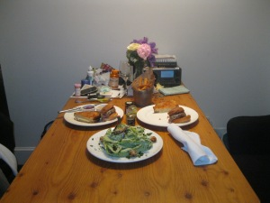 """Room service dinner in our hipster room, Lisa is playing """"Fire and Rain"""" on our room's acoustic guitar."""