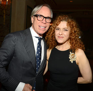 Here is Bernadette Peters, who was born in 1948, with Tommy Hilfiger.