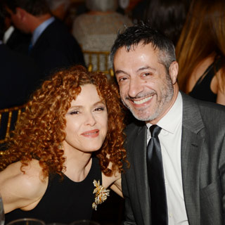 This 65 year old Bernadette Peters with her date, I guess or her son.