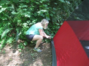 Me hammering in the little metal things that hook the tent to the ground. Deren hammered it in once photo was taken.
